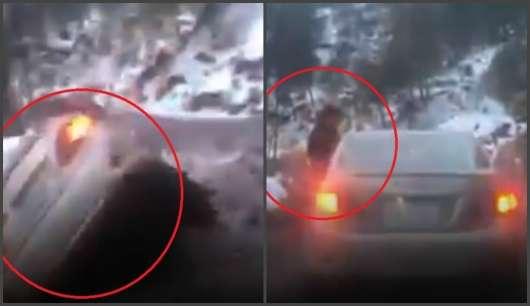Автомобіль падає з вузької гірської дороги, коли пасажир висовується з вікна